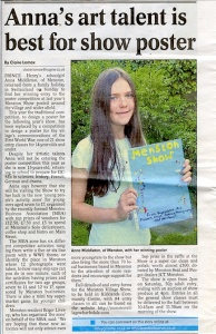 A picture of Anna Middleton with her poster, chosen to advertising the 2014 Menston Village Show